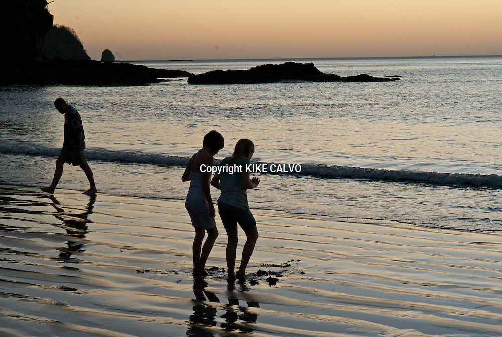 With the sun slowly setting down on the horizon, friends Sasha Scudder and Emma Wulfhorst play with the sand and the waves at the sandy area at Prieta Beach Club and Spa in Costa Rican Peninsula Papagayo. B1276