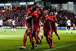 Ben Woodburn of Wales celebrates with teammates after scoring a goal to make it 1-0 - Mandatory by-line: Robbie Stephenson/JMP - 20/03/2019 - FOOTBALL - The Racecourse Ground - Wrexham, United Kingdom - Wales v Trinidad and Tobago - International Challenge Match