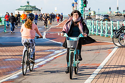 © Licensed to London News Pictures. 10/11/2019. Brighton, UK. A Handful of members of the public take to the beach in Brighton and Hove as sunny weather is hitting the seaside resort. Photo credit: Hugo Michiels/LNP