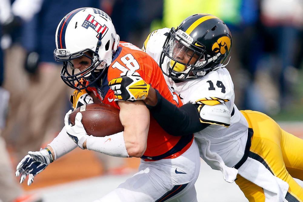 Illinois wide receiver Mike Dudek (18) runs the ball as Iowa defensive back Desmond King (14) tackles him from behind during the first half of an NCAA college football game at Memorial Stadium Saturday, Nov. 15, 2014, on the University of Illinois campus in Champaign, Ill. (Lee News Service/ Stephen Haas)