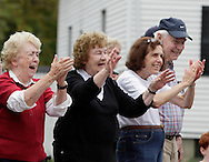 Salisbury Mills, New York - People applaud  as fire departments and bands march down Route 94 during the Orange County Volunteer Firemen's Association (OCVFA) annual parade on Sept. 24, 2011.