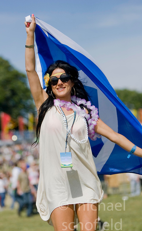 Kaya Assadi with a saltire near the main stage. Rockness, Sunday 8th June 2008..Pic © Michael Schofield. All Rights Reserved.