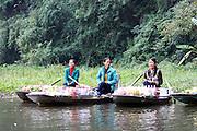 foot rowing Tam Coc area of Ngo Dong River near Ninh Binh, Vietnam