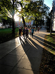 Students at the University of Wisconsin-Madison walk down Bascom Hill on a fall afternoon.