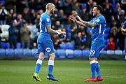 Peterborough Utd forward Marcus Maddison (21) celebrates his second goal with Peterborough Utd's Lee Tomlin (29) during the EFL Sky Bet League 1 match between Peterborough United and Wycombe Wanderers at London Road, Peterborough, England on 2 March 2019.