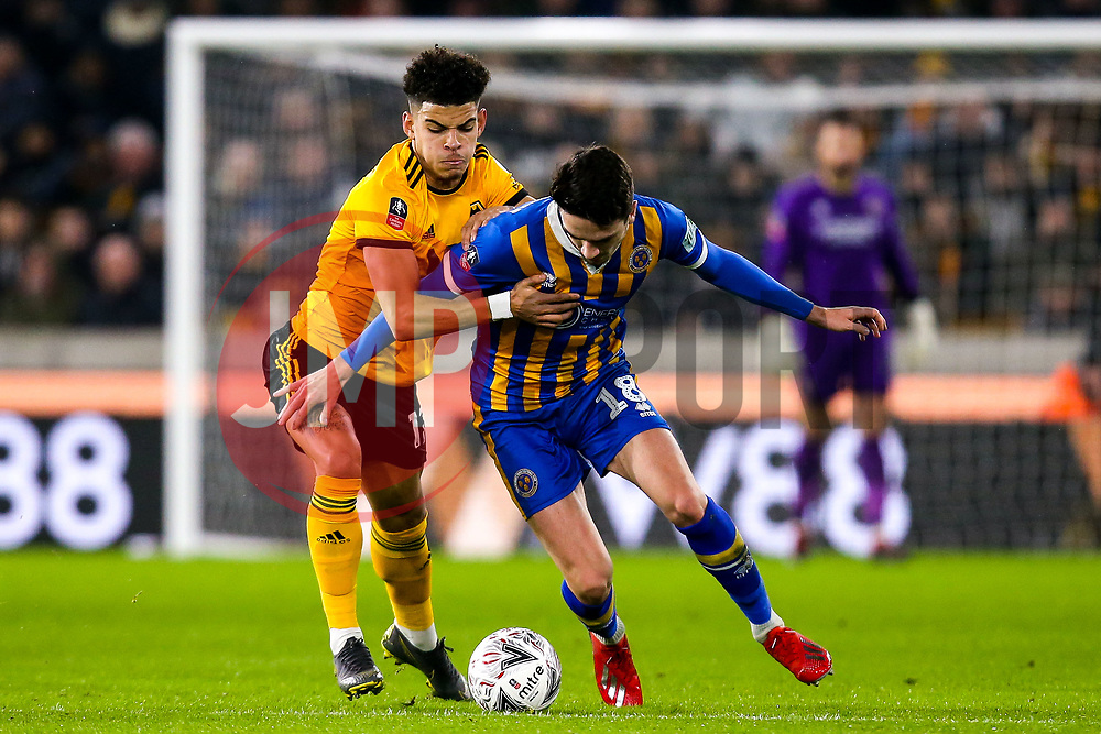 Alex Gilliead of Shrewsbury Town takes on Morgan Gibbs-White of Wolverhampton Wanderers - Mandatory by-line: Robbie Stephenson/JMP - 05/02/2019 - FOOTBALL - Molineux - Wolverhampton, England - Wolverhampton Wanderers v Shrewsbury Town - Emirates FA Cup fourth round replay