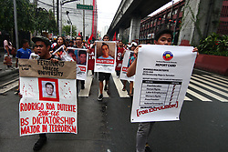 July 6, 2018 - Philippines - Students holding banners as they march towards Mendiola Bridge, near the presidential palace to denounce, and condemn, the recent deaths of civilians and alleged human rights violation of the current administration. According to the protesters, ''Duterte's reign of terror spreads over the land as if an undeclared Martial Law has been put into place. (Credit Image: © J Gerard Seguia via ZUMA Wire)