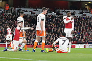 Arsenal defender Shkodran Mustafi (20) and Arsenal striker Danny Welbeck (23) pointing, directing, signalling during the EFL Cup 4th round match between Arsenal and Blackpool at the Emirates Stadium, London, England on 31 October 2018.