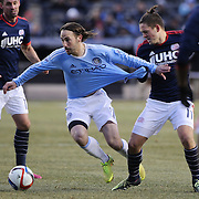 Ned Grabavoy, (left), NYCFC, is held by Kelyn Rowe, New England Revolution, during the New York City FC v New England Revolution, inaugural MSL football match at Yankee Stadium, The Bronx, New York,  USA. 15th March 2015. Photo Tim Clayton