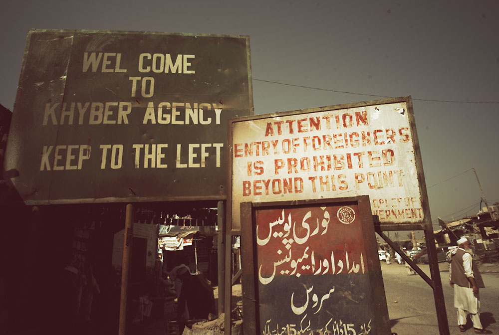 A sign on the outskirts of Peshawar warning foreigners that entry is prohibited beyond this point at the Smuggler's Bazaar, Khyber-Pakhtunkhwa, Pakistan on 25th Sep, 2007...