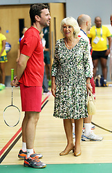 Image licensed to i-Images Picture Agency. 23/07/2014. Glasgow, United Kingdom. The Duchess of Cornwall talks to England badminton player Peter Jeffrey during a visit  to the Commonwealth Games in Glasgow  Picture by Stephen Lock / i-Images