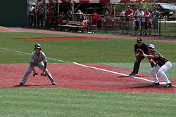 26 April 2014:  Tyler Rolland takes a lead from first base and Brian Rodemoyer as umpire Grady Smith looks on during an NCAA Division 1 Missouri Valley Conference (MVC) Baseball game between the Southern Illinois Salukis and the Illinois State Redbirds in Duffy Bass Field, Normal IL