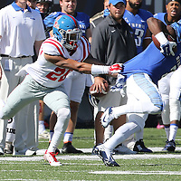 Lauren Wood | Buy at photos.djournal.com<br /> Ole Miss defensive back Cam Ordway tries to pull down Memphis wide receiver Anthony Miller during Saturday's game at Memphis.