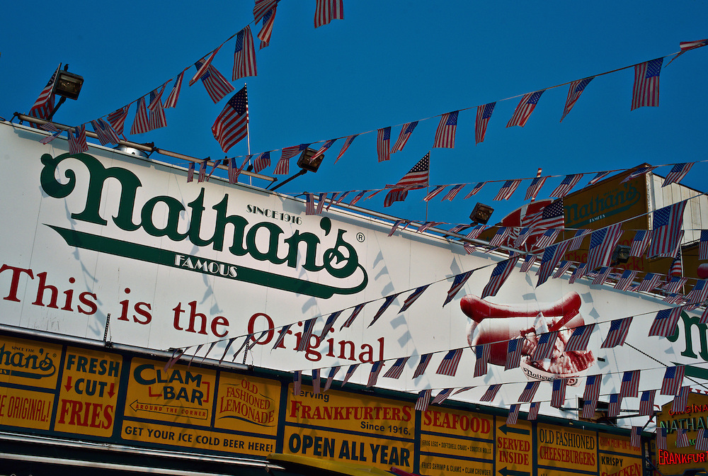 """This is the original"" sign outside Nathan's hot dog stand, Coney Island, New York"