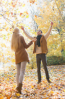 Full length of couple enjoying in autumn