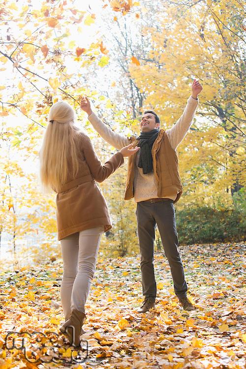 Full length of couple enjoying in autumn