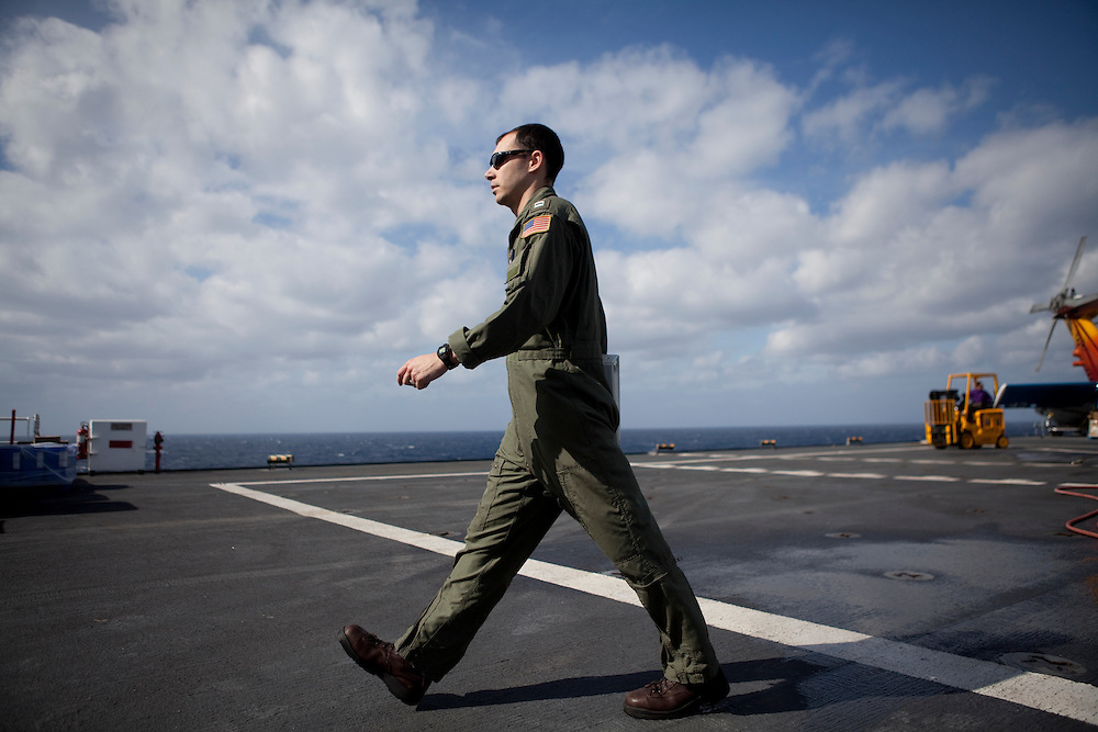 A member of HSC 28, a helicopter sea combat detachment out of Norfolk, Virginia, walks on the flight deck of the USNS Comfort, a naval hospital ship, as the ship makes its way to help survivors of the earthquake in Haiti on Monday, January 18, 2010 in the Atlantic Ocean off the coast of the United States.