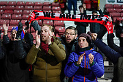 Lincoln City fans celebrate coming away with 1 point during the EFL Sky Bet League 2 match between Swindon Town and Lincoln City at the County Ground, Swindon, England on 12 January 2019.
