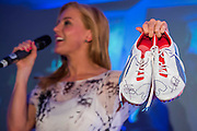 Sarah-Jane Mee, Sky Sports, auctions a pair of Usain Bolt's running shoes - UK charity, Sport for Freedom (SFF), marks Anti-Slavery Day 2015 by hosting a charity Gala Dinner, supported by Aston Martin, on Thursday 15th October at Stamford Bridge, home of Chelsea Football Club. This inaugural event brought together people from the world of sport, entertainment, media, and business to unite behind a promise to tackle the issue of modern day human trafficking and slavery.  <br /> Hosted by Sky presenters Sarah-Jane Mee and Jim White, the Sport for Freedom Gala Dinner includes guests such as jockey AP McCoy OBE; Denise Lewis, former British Olympic Gold Medal winner; BBC Strictly star, Brendan Cole; Al Bangura, former Watford FC player and Sport for Freedom Ambassador who was trafficked from Africa to the UK at the age of just 14yrs old; Made in Chelsea star, Ollie Proudlock; ITV weather presenter, Lucy Verasamy; Sky Sports F1 presenter and SFF Ambassador, Natalie Pinkham; Premier League footballers Ryan Bertrand of Southampton FC and Troy Deeney of Watford FC and champion boxer, Anthony Joshua; and The UK's first independent Anti Slavery Commissioner, Kevin Hyland OBE, who highlighted the issues of modern day slavery that face the UK and world today. <br /> The evening concluded with chart topping music from 'Naughty Boy'. <br /> Sport for Freedom are also joining forces with the Premier League Academies for an international  'Football for Freedom' tournament with their U16's players that will also involve educating those taking part about the issues surrounding modern day slavery. The final will take place at Liverpool FC's Academy on Anti-Slavery Day, 18th October.