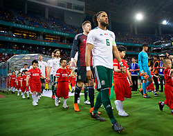 NANNING, CHINA - Thursday, March 22, 2018: Wales' captain Ashley Williams leads his side out to face China before the opening match of the 2018 Gree China Cup International Football Championship between China and Wales at the Guangxi Sports Centre. (Pic by David Rawcliffe/Propaganda)