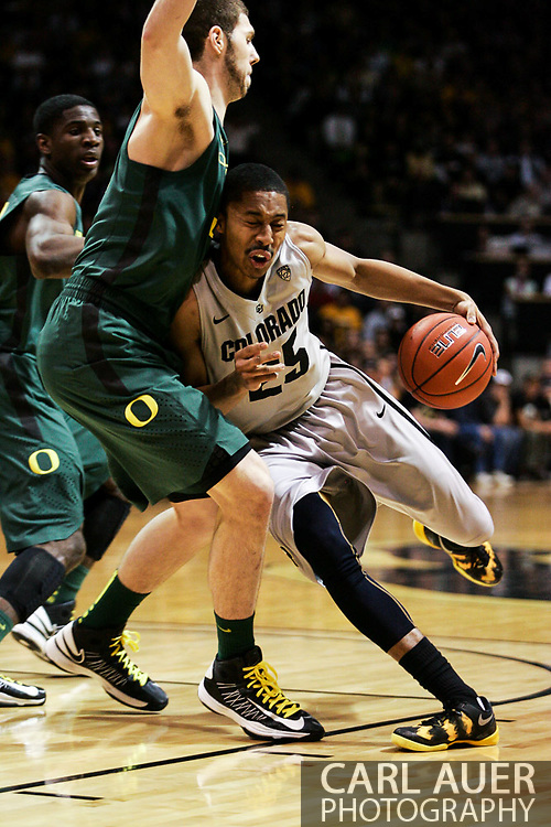 March 3, 2013: Boulder, Colorado - Colorado Buffaloes sophomore guard Spencer Dinwiddie (25) tries to dribble around the Oregon defense in the Colorado Buffaloes game against the University of Oregon Ducks at the Coors Events Center