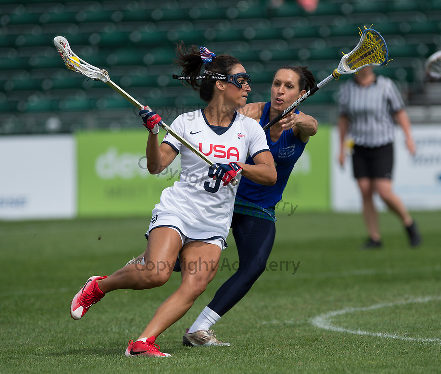 USA's Kelly Rabil challenges with Scotland's Julia Paterson during their opening game of the 2017 FIL Rathbones Women's Lacrosse World Cup, at Surrey Sports Park, Guildford, Surrey, UK, 13th July 2017.