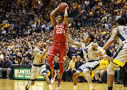 Jan 6, 2018; Morgantown, WV, USA; Oklahoma Sooners guard Kameron McGusty (20) passes the ball across court during the first half against the West Virginia Mountaineers at WVU Coliseum. Mandatory Credit: Ben Queen-USA TODAY Sports