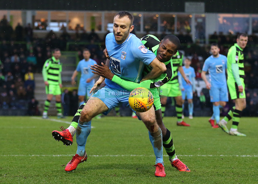 Coventry City's Liam Kelly is fouled by Forest Green Rovers Dale Bennett and is awarded a free kick