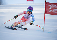 Peyton Hadfield races for the Gunstock Ski Club during the annual Gus Pitou Memorial giant slalom on Sunday at Gunstock.  (Karen Bobotas/for the Laconia Daily Sun)