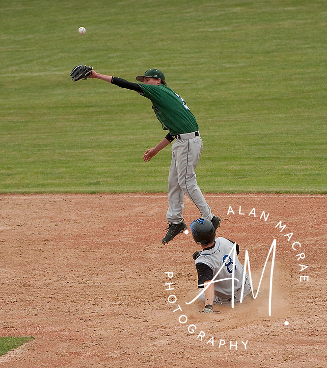 Winnisquam's Matt Roy slides safely onto second as Hopkinton second baseman Jimmy Angell misses the throw during Wednesday's NHIAA class M semi-final game at Concord's Memorial Field.  (Alan MacRae/for the Citizen)