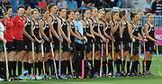 Team line up for the national anthem during a Black Sticks Women v South Africa preliminary pool match at the Glasgow National Hockey Stadium. Glasgow Commonwealth Games 2014. Monday 28 July 2014. Scotland. Photo: Andrew Cornaga/www.Photosport.co.nz
