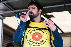 London, UK. 1st December, 2018. Richard Roberts, an anti-fracking campaigner who recently had a prison sentence overturned, addresses the Together for Climate Justice demonstration against Government policies in relation to climate change, including Heathrow expansion and fracking. Following a rally outside the Polish embassy, chosen to highlight the UN's Katowice Climate Change Conference which begins tomorrow, protesters marched to Downing Street.