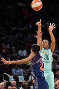 Tanisha Wright #30 of the New York Liberty shoots the ball over DeWanna Bonner #24 of the Phoenix Mercury during the second round of the WNBA Playoffs at Madison Square Garden in New York on September 24, 2016. (Cooper Neill for The New York Times)