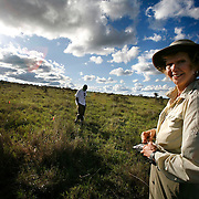 Dr. Diana H. Wall, from the Natural Resource Ecology lab at Colorado State University,  takes soil samples during a research trip to look at below ground animal diversity at  Kapiti Plains near Machakos, Kenya.  She is assisted by  ILRI (International Livestock Research Institute) workers.