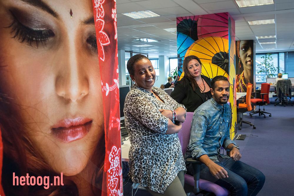 The Netherlands, Nederland hengelo 25sept2015 vluchtelingen krijgen een opleiding tot tolk vertaler bij TVCN (tolk en vertaal centrum nederland, vlnr. mevr. Ayal Gebre, mevr. Emma Sayed en dhr. Ramy