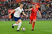 Lucia Bronze (2) of England on the attack chased by Natasha Harding (7) of Wales during the FIFA Women's World Cup UEFA Qualifier match between England Ladies and Wales Women at the St Mary's Stadium, Southampton, England on 6 April 2018. Picture by Graham Hunt.