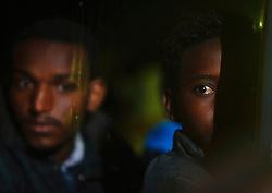 African would-be immigrants look on as they sit in a police bus after disembarking from a patrol boat at the Armed Forces of Malta Maritime Squadron base at Haywharf, in Valletta's Marsamxett Harbour late November 9, 2012.  A group of 246 immigrants, mostly from Eritrea, landed in Malta late on Friday after having been rescued from a drifting boat some 75 nautical miles (139 kilometres) south-east of the island, the Maltese armed forces said.  REUTERS/Darrin Zammit Lupi (MALTA - Tags: SOCIETY IMMIGRATION) MALTA OUT. NO COMMERCIAL OR EDITORIAL SALES IN MALTA - RTR3A7Z2