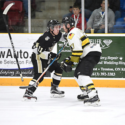 TRENTON, ON  - MAY 2,  2017: Canadian Junior Hockey League, Central Canadian Jr. &quot;A&quot; Championship. The Dudley Hewitt Cup. Game 2 between Powassan Voodoos and the Trenton Golden Hawks. Jordan Chard #11 of the Trenton Golden Hawks battles for control with Ryan Bazzana #21 of the Powassan Voodoos during the second period.<br /> (Photo by Andy Corneau / OJHL Images)