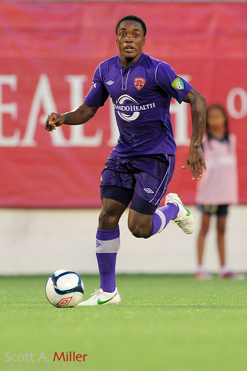 Orlando City Lions defender Mechack Jerome (2) brings the ball upfield against the Wilmington Hammerheads at the Florida Citrus Bowl on July 25, 2012 in Orlando, Florida. ..©2012 Scott A. Miller