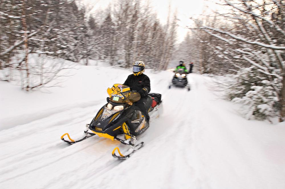 Snowmobilers on  Trail 3 near Lake Linden Michigan.
