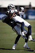 Los Angeles Rams rookie wide receiver Steven Mitchell (86) gets lifted in the air and slammed to the ground by Oakland Raiders cornerback Antonio Hamilton (32) after catching a third quarter pass plus an unnecessary roughness penalty good for a first down at the Raiders 26 yard line during the 2018 NFL preseason week 2 football game against the Oakland Raiders on Saturday, Aug. 18, 2018 in Los Angeles. The Rams won the game 19-15. (©Paul Anthony Spinelli)
