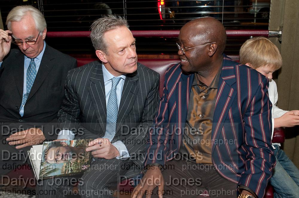 SIMON MANN; HIS LEGAL PRACTITIONER; JONATHAN SAMUKANJE ; ARTHUR MANN, Simon Mann and Marco Pierre White: Book launch for 'Cry Havoc' . Wheelers's. St. james's. London. 26 October 2011. <br /> <br />  , -DO NOT ARCHIVE-© Copyright Photograph by Dafydd Jones. 248 Clapham Rd. London SW9 0PZ. Tel 0207 820 0771. www.dafjones.com.