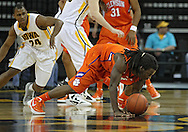 November 29, 2011: Clemson Tigers guard Rod Hall (4) tries to control the ball during the first half of the NCAA basketball game between the Clemson Tigers and the Iowa Hawkeyes at Carver-Hawkeye Arena in Iowa City, Iowa on Tuesday, November 29, 2011. Clemson defeated Iowa 71-55 in the Big Ten-ACC Challenge game.