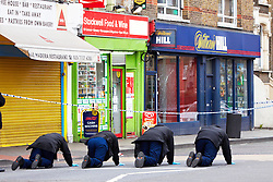 © under license to London News Pictures. 30/03/2011.  Police conduct a fingertip search of the area outside the Stockwell Food & Wine shop, Stockwell Road, Brixton where a 5 year old girl and a 35 year old man were shot last night. Photo credit should read Cliff Hide/LNP...