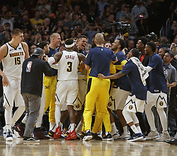 October 21, 2018 - Denver, Colorado, U.S - The Denver Nuggets bench celebrates on the end line after defeating the Warriors at the Pepsi Center Sunday night. The Nuggets beat the Warriors 100-98. (Credit Image: © Hector Acevedo/ZUMA Wire)