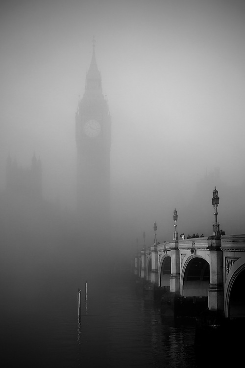 A view of Big Ben and Westminster Bridge through the fog.<br />