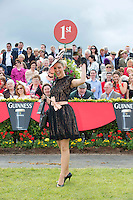 02/08/2012. Repro free first use. The winner of the Anthony Ryan's Best Dressed Lady Competition on Ladies Day at the Galway Races is 22 year old Kelli O' Dell , a student from New-South Wales Australia.  Ms O'Dell wore an ?Anaessia? Black lace dress, with champagne underlay, matching sash and butterfly broaches.  It was accessorized with black patent Tony Bianco Shoes and her grandmother's black gloves.  Photo:Andrew Downes..