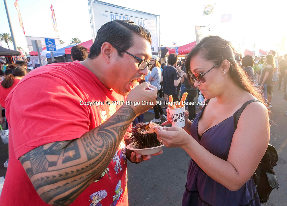 People enjoy the food at the '626 Night Market' on June 30, 2017 in Arcadia, California, an event that attracts all generations of the Chinese American community and showcases many San Gabriel Valley food vendors.(Photo by Ringo Chiu)<br /> <br /> Usage Notes: This content is intended for editorial use only. For other uses, additional clearances may be required.