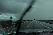 Traffic moves through rain on Interstate 10 in Benson, Arizona, USA.
