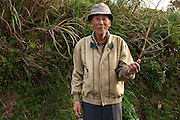 Mr Shinsaro ISA, 85,(伊佐真三郎)lives in the remote Takae district near the new Osprey helipads. <br /> <br /> He spends his afternoons picking up cigarette butts along the main road and worries about the environmental pollution caused by the new bases. He's also concerned about the endangered bird, the Okinawa rail. <br /> <br /> Okinawa rail (Gallirallus okinawae) is a species of bird in the rail family. It is endemic to Okinawa Island in Japan where it is known as the Yanbaru kuina (ヤンバルクイナ(山原水鶏)<br /> <br /> The construction of Osprey helipads inside the U.S. Marines' Jungle Warfare Training Center, or Camp Gonsalves has been another cause of deep discontent of the local population concerned about the destruction of a well preserved wild environment.<br /> <br /> The Osprey aircraft has become a lightning rod for opposition to the U.S. military presence in Okinawa, with local groups seeking the closure of American bases saying it is prone to crash and poses a danger to residents.